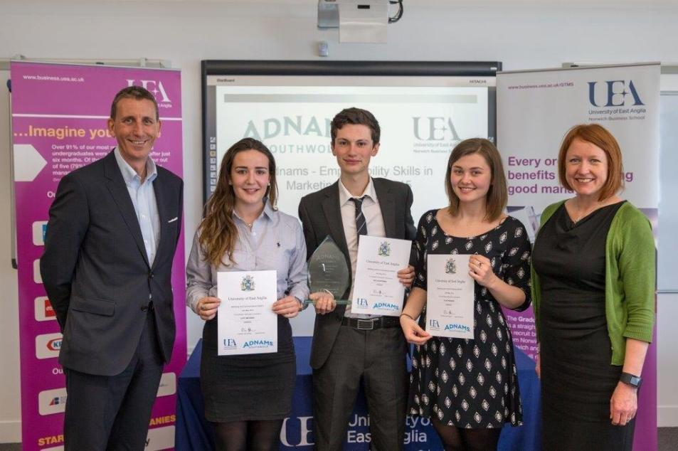 The winning team receiving their trophy. From left to right: Andy Wood (Adnams), Lucy McVeigh, Declan Byrnes, Ellie Kedzlie and Emma Hibbert (Adnams)