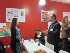 Helen Mounser finding out about the business challenges from a delegate, James Palmer, SaxonAir.