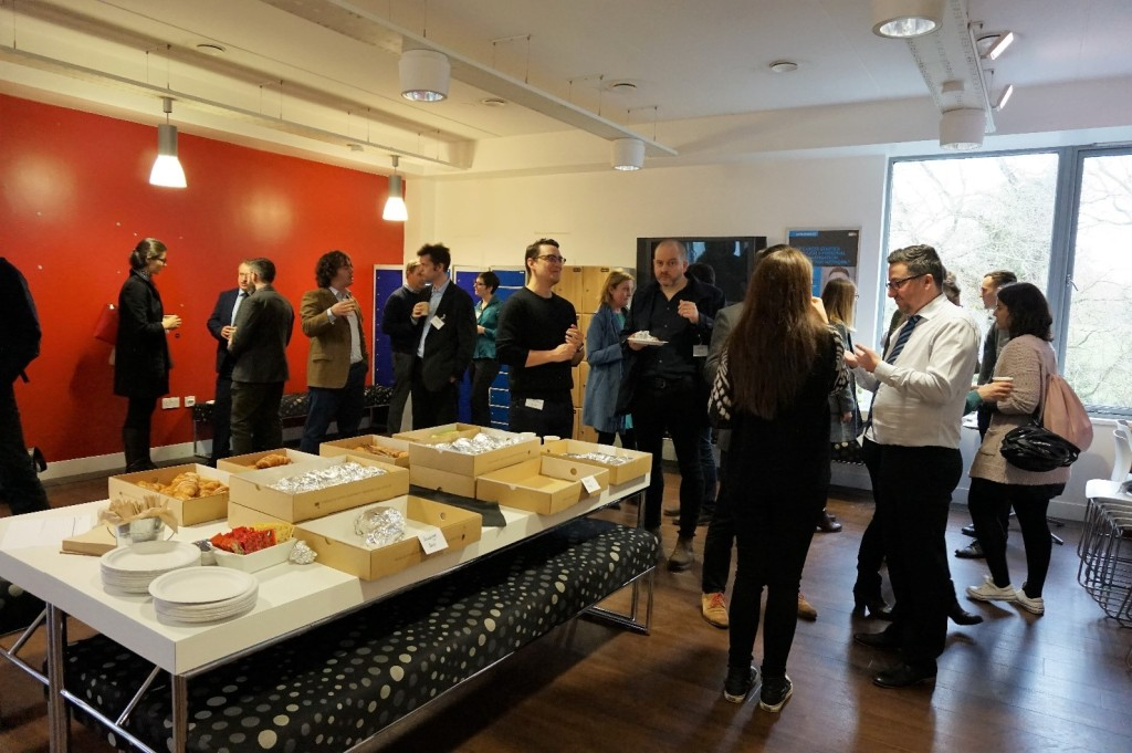 A photo of business breakfast attendees socialising
